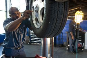 Image of Brakes being repaired by AAMCO Mechanic