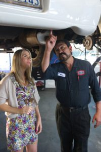 Image of AAMCO Mechanic Showing Customer car issue